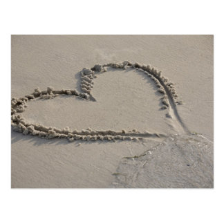 High angle view of a heart shape on the beach postcard