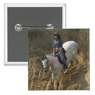 High angle view of a young woman riding a horse 2 inch square button