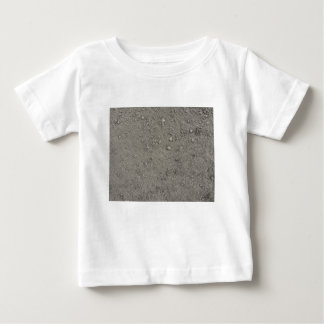 High angle view of brown ground baby T-Shirt