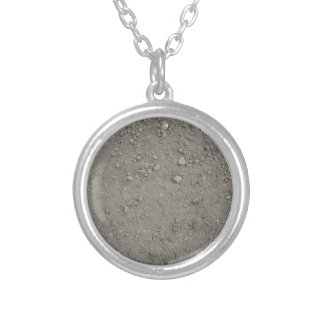 High angle view of brown ground silver plated necklace