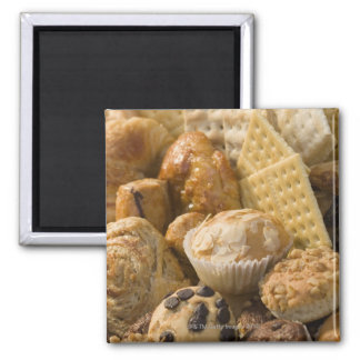 High angle view of muffins and crackers in a square magnet