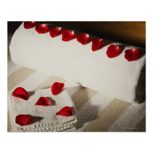High angle view of rose petals on towels poster