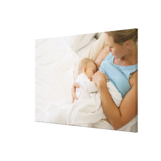 High angle view of woman breastfeeding baby canvas print