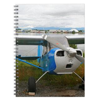 High wing aircraft, blue & white, Alaska Notebook