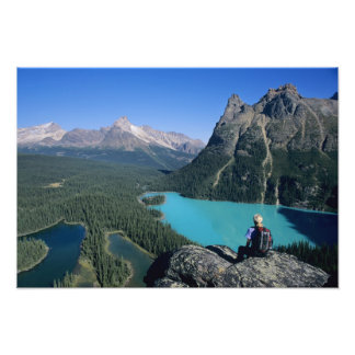 Hiker overlooking turquoise-colored Lake Photo