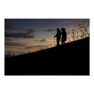 Hikers descending at sunset poster