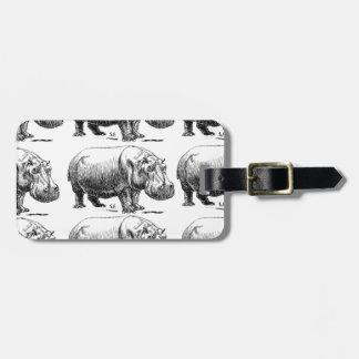 hippopotamus gold luggage tag