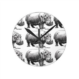 hippopotamus gold round clock