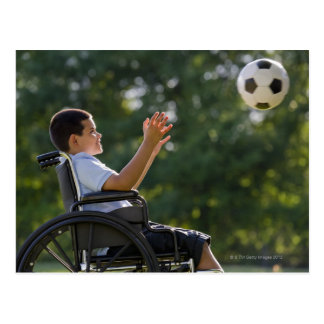 Hispanic boy, 8, in wheelchair with soccer ball postcard