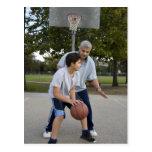 Hispanic father and son playing basketball post card