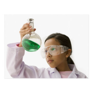 Hispanic girl looking at liquid in beaker postcard