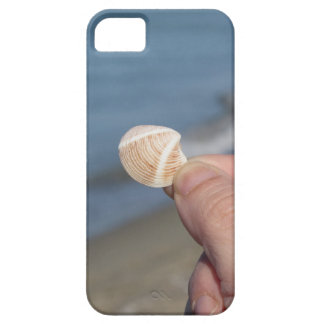 Holding a seashell in the hand case for the iPhone 5