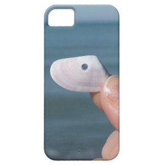 Holding a seashell in the hand with blue sea iPhone 5 covers