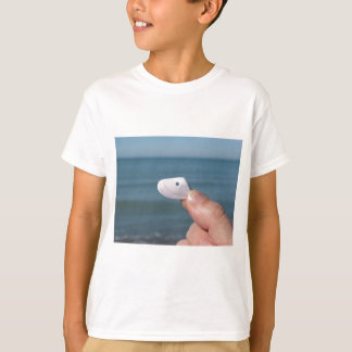 Holding a seashell in the hand with blue sea T-Shirt