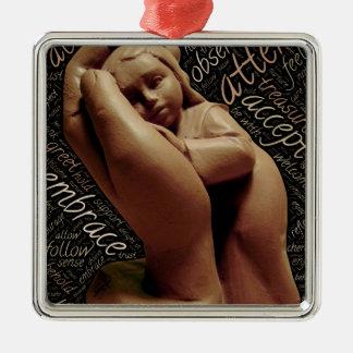 holding child metal ornament