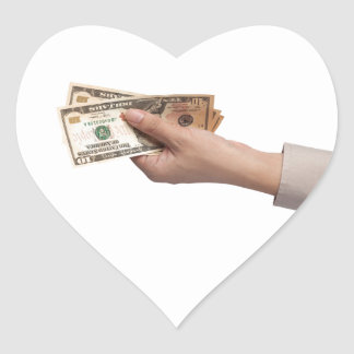 Holding money heart sticker