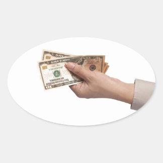 Holding money oval sticker
