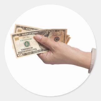 Holding money round sticker