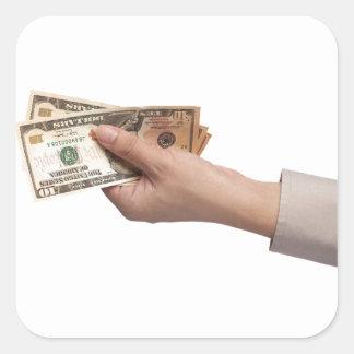 Holding money square sticker