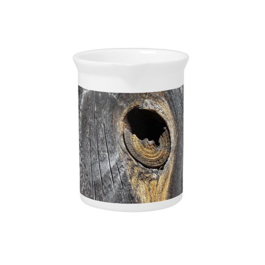 hole in fence beverage pitcher