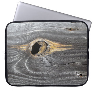 hole in fence computer sleeve