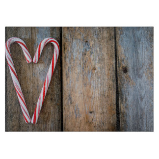 Holiday Heart Candy Canes on Rustic Wood Cutting Board