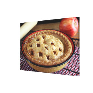 Home baked apple pie on cooling rack with apple stretched canvas print