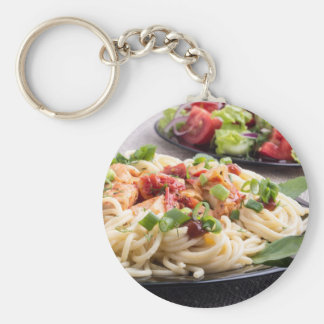 Home-cooked meals on a gray mat - spaghetti basic round button keychain