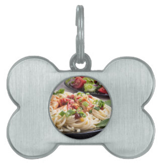 Home-cooked meals on a gray mat - spaghetti pet name tag