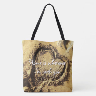 """Home is"" quote heart drawn in sand photo tote bag"