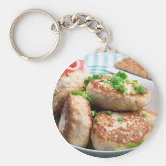 Homemade chicken burgers and tomato salad basic round button keychain