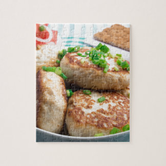 Homemade chicken burgers and tomato salad jigsaw puzzle
