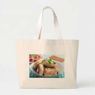 Homemade chicken burgers and tomato salad large tote bag