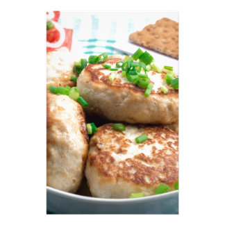 Homemade chicken burgers and tomato salad stationery