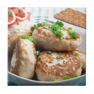 Homemade chicken burgers and tomato salad tiles
