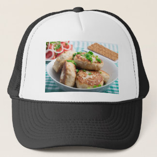 Homemade chicken burgers and tomato salad trucker hat