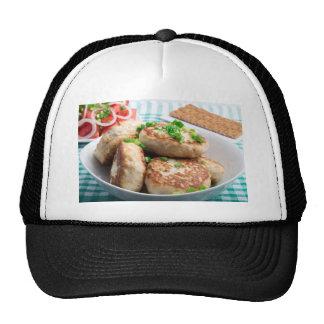 Homemade chicken burgers and tomato salad trucker hat