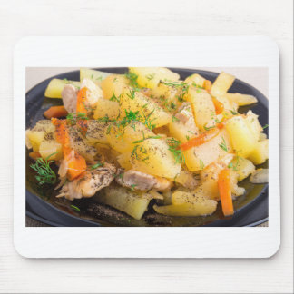 Homemade dish of slices of stewed potatoes mouse pad