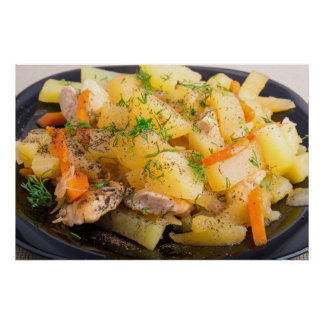 Homemade dish of slices of stewed potatoes poster