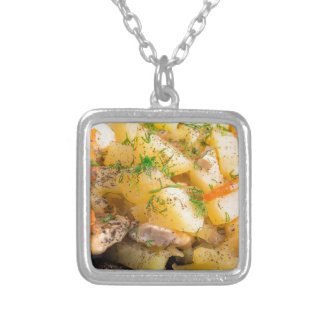 Homemade dish of slices of stewed potatoes silver plated necklace