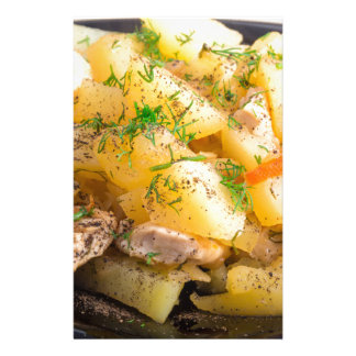 Homemade dish of slices of stewed potatoes stationery