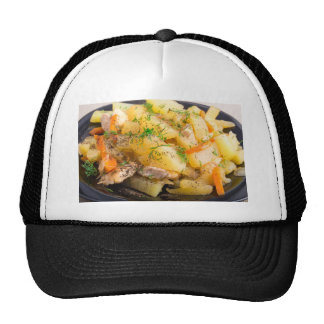 Homemade dish of slices of stewed potatoes trucker hat