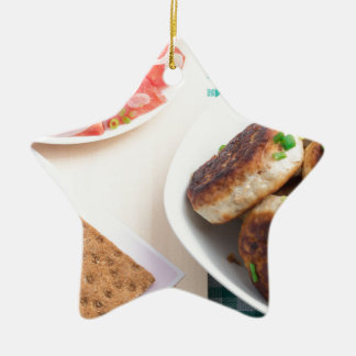 Homemade fried meatballs on a green tablecloth ceramic star ornament