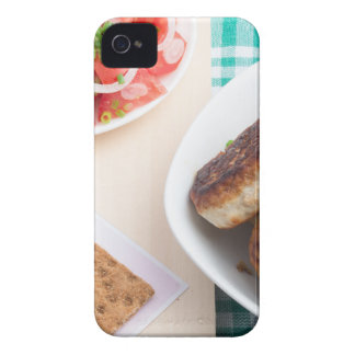 Homemade fried meatballs on a green tablecloth iPhone 4 covers