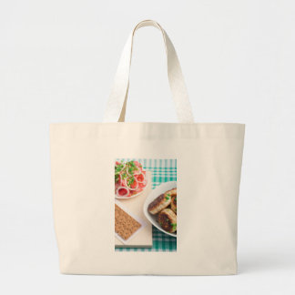 Homemade fried meatballs on a green tablecloth large tote bag