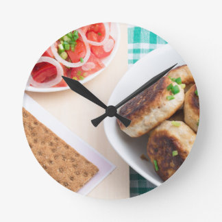 Homemade fried meatballs on a green tablecloth round clock
