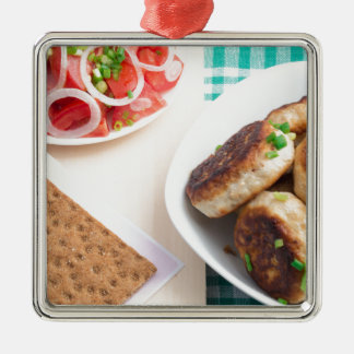 Homemade fried meatballs on a green tablecloth Silver-Colored square ornament