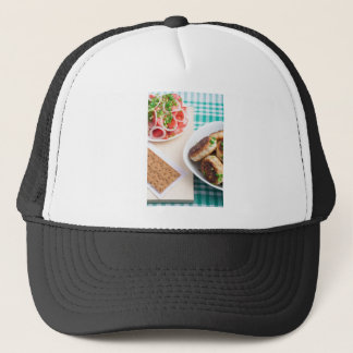 Homemade fried meatballs on a green tablecloth trucker hat