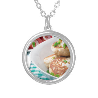 Homemade meatballs close up on the table silver plated necklace