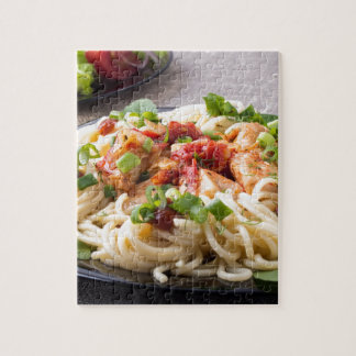 Homemade pasta with stewed chicken and vegetable puzzles